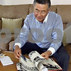 Shu Ueyama looks though his 1963 Sandwich High School Yearbook on Saturday at the home of Barb Makela in Sycamore. Ueyama came to Sandwich from Japan in 1962 as a foreign exchange student and stayed at Makela's home for his stay. He returned to the area this weekend for his 50th high school reunion. (John Sahly – jsahly@shawmedia.com)