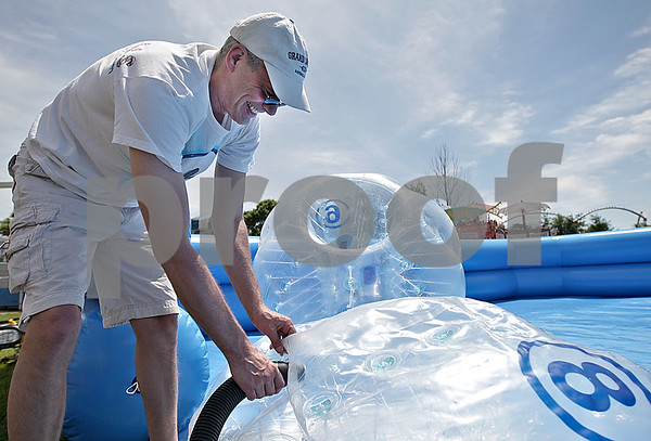 Monica Maschak - mmaschak@shawmedia.com<br /> Peter Bogolin, owner of Wowballs USA, fills giant balls with air for kids to enjoy Body Bumperz at the Malta Days festival at Lions Park on Saturday, June 8, 2013.