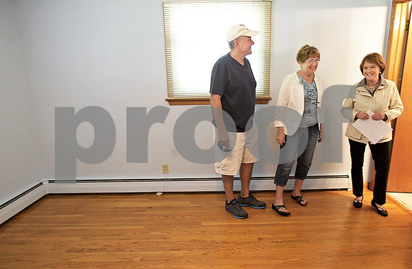 Monica Maschak - mmaschak@shawmedia.com<br /> Realtor Sharon Rhoades, with McCabe Realtors, shows a home to DeKalb couple Phyllis and Dan Anderson on Friday, June 7, 2013. This was the second visit to this home for the Andersons, who are looking to move into a ranch home in the area.