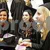 Monica Maschak - mmaschak@shawmedia.com<br /> Sabrina Killeen, Hannah Hart and Carlie Hayes crouch down while they pass the time before lining up for the DeKalb High School commencement ceremony at the Northern Illinois University Convocation Center on Saturday, June 8, 2013. About 350 students graduated.