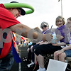 Monica Maschak - mmaschak@shawmedia.com<br /> Cancer survivor Raegan Mann, 6, of DeKalb, receives a balloon poodle from cancer survivor Roger Ray during the 17th annual Relay for Life of DeKalb County at Sycamore High School on Friday, June 14, 2013. Mann has been in remission from ganglioneuroblastoma for three years and Ray has been in remission from Hodgkin's Lymphoma for 9 years. Survivors, caregivers and supporters walked and raised money from 6 p.m. Friday until 6 a.m. Saturday.