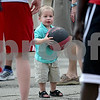 Monica Maschak - mmaschak@shawmedia.com<br /> Brandon Seabase, 2, of Sycamore, passes a basketball back and forth with basketball players during the Northern Illinois University Night in downtown Sycamore on Tuesday, June 11, 2013. The event was part of Sycamore's monthly Tuesdays on the Town. About 20-30 NIU athletes hung out with kids, shot hoops and signed autographs.