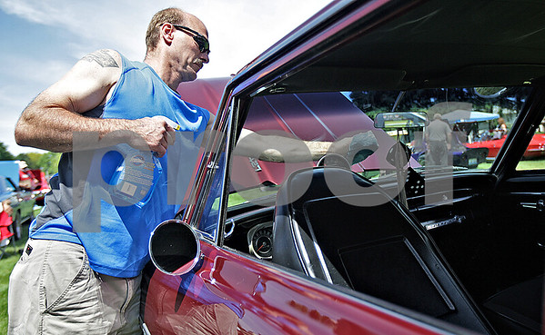 Monica Maschak - mmaschak@shawmedia.com<br /> Dan Mootrey washes the windshield of his 1963 Chevy II Nova at the Malta Days' car show at Lions Park on Saturday, June 8, 2013.