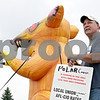 Rob Winner – rwinner@shawmedia.com<br /> <br /> Keith Maier of Laborers' Local 32 stands outside the Kishwaukee Family YMCA in DeKalb next to an oversized inflatable rat for an informational picket on Monday, June 10, 2013.