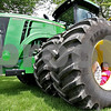 Monica Maschak - mmaschak@shawmedia.com<br /> Brennan Sowa, 14, curls up into a large tractor tire at the Malta Days festival at Lions Park on Saturday, June 8, 2013.