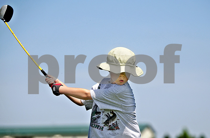 Monica Maschak - mmaschak@shawmedia.com<br /> Royce Gradls, 6, of Sycamore, practices his golf swing at Sycamore Community Park on Friday, June 14, 2013. Gradls took advantage of the warm weather and clear skies before the forecasted storms this weekend.