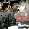 Monica Maschak - mmaschak@shawmedia.com<br /> Dontaye Bradley laughes during the DeKalb High School commencement ceremony at the Northern Illinois University Convocation Center on Saturday, June 8, 2013. About 350 students graduated.