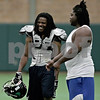Monica Maschak - mmaschak@shawmedia.com<br /> Running back Gary Bennett laughs with full back Jermaine Weathers during practice at the recreation center in DeKalb on Thursday, June 20, 2013.