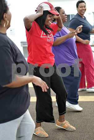 Monica Maschak - mmaschak@shawmedia.com<br /> LaMetra Curry-Chatman improvises her own moves during a free Zumba class lead by Myisha Hill at the New Hope Missionary Baptist Church on Thursday, June 13, 2013.