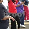 Monica Maschak - mmaschak@shawmedia.com<br /> LaMetra Curry-Chatman improvises her own moves during a free Zumba class lead by Myisha Hill at the New Hope Missionary Baptist Church on Thursday, June 13, 2013.