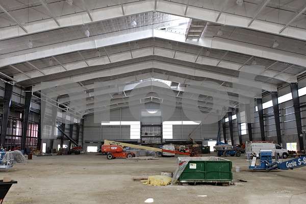 Rob Winner – rwinner@shawmedia.com<br /> <br /> Inside the new Chessick Practice Center on the Northern Illinois University campus during construction in DeKalb, Ill., on Friday, June 14, 2013. The football field inside the center will be regulation size.