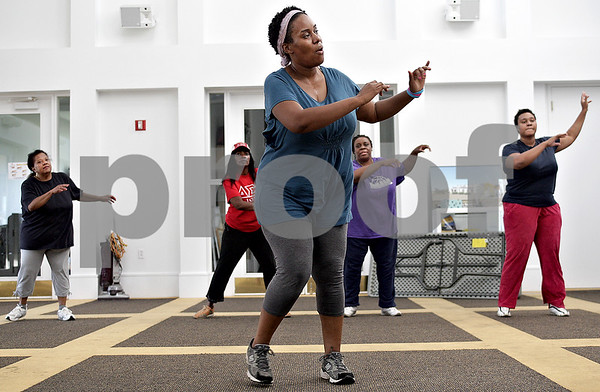 Monica Maschak - mmaschak@shawmedia.com<br /> Myisha Hill leads a group of women in a free Zumba class at the New Hope Missionary Baptist Church in DeKalb on Thursday, June 13, 2013.