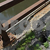 Rob Winner – rwinner@shawmedia.com<br /> <br /> A damaged portion of the bridge over the Kishwaukee River on Five Points Road in Kingston, Ill. is seen on Tuesday, June 18, 2013.