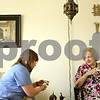 Rob Winner – rwinner@shawmedia.com<br /> <br /> Registered nurse Tanya Diedrich (left), of DeKalb County Hospice, discusses medications with Jocelyn Green at Green's home in DeKalb, Ill., Monday, June 17, 2013.