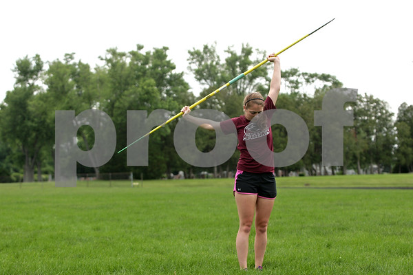 Rob Winner – rwinner@shawmedia.com<br /> <br /> DeKalb graduate Stephanie Milroy stretches between javelin throws while practicing at Huntley Middle School in DeKalb, Ill., Wednesday, June 12, 2013. Milroy will continue her track career at Southern Illinois University.