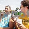 Monica Maschak - mmaschak@shawmedia.com<br /> Caleb Meyers (left), 20, and Taylor Stinnett, 20, take a break from their bike ride to enjoy shaved ice at Tropical Sno in Sycamore on Monday, June 17, 2013.