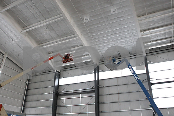 Rob Winner – rwinner@shawmedia.com<br /> <br /> Electricians are seen installing wire for the lights inside the new Chessick Practice Center on the Northern Illinois University campus in DeKalb, Ill., on Friday, June 14, 2013.