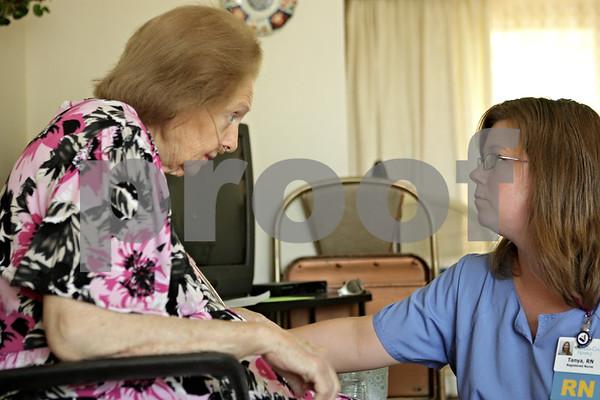 Rob Winner – rwinner@shawmedia.com<br /> <br /> Hospice patient Jocelyn Green (left) discusses medications with registered nurse Tanya Diedrich (left), of DeKalb County Hospice, at Green's home in DeKalb, Ill., Monday, June 17, 2013.