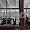 Rob Winner – rwinner@shawmedia.com<br /> <br /> Construction workers are seen inside the new Chessick Practice Center on the Northern Illinois University campus in DeKalb, Ill., on Friday, June 14, 2013.