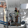Rob Winner – rwinner@shawmedia.com<br /> <br /> Construction workers are seen performing duct work inside the new Chessick Practice Center on the Northern Illinois University campus in DeKalb, Ill., on Friday, June 14, 2013.