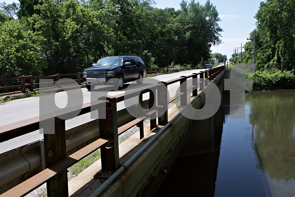 Rob Winner – rwinner@shawmedia.com<br /> <br /> A vehicle is seen traveling northbound over a bridge on the Kishwaukee River on Five Points Road in Kingston, Ill., Tuesday, June 18, 2013.