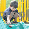 Monica Maschak - mmaschak@shawmedia.com<br /> Roberto Carrillo, 3, releases his toy trucks down a slide at Huntley Park in DeKalb on Monday, June 17, 2013.