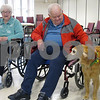 Richard Zekoff, a resident at the DeKalb County Nursing & Rehab Center, pets Buddy, a 10-year-old golden retriever who visits local nursing homes through TAILS Humane Society's Pawsitive TAILS program.