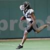 Monica Maschak - mmaschak@shawmedia.com<br /> Running back Gary Bennett runs a play with the ball during an Illinois Chaos practice at the recreation center in DeKalb on Thursday, June 20, 2013.