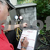 Rob Winner – rwinner@shawmedia.com<br /> <br /> Gregory Freeman owner of All-Star Heating and Air Conditioning uses a check list while performing a tune-up on an air conditioner unit at a home in DeKalb on Tuesday, June 25, 2013. According to Freeman, homeowners can save an average of 10% on electricity costs by having a certified technician check that their central air unit is running properly and cleaned.