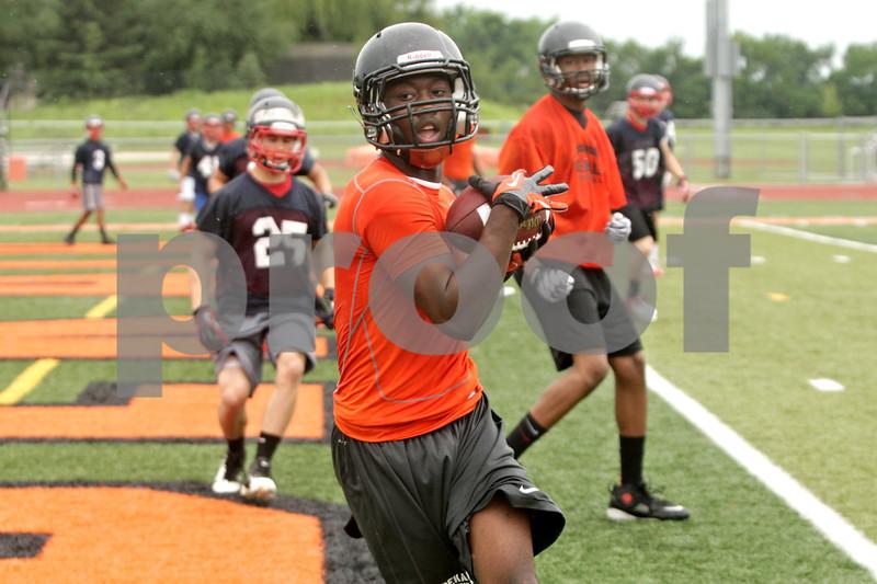 Rob Winner – rwinner@shawmedia.com<br /> <br /> DeKalb's Demetrios Collins catches a touchdown pass during a 7-on-7 game against Belvidere North at DeKalb High School on Monday, June 24, 2013.