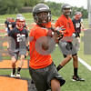 Rob Winner – rwinner@shawmedia.com<br /> <br /> DeKalb's Demetrios Collins catches a touchdown pass during a 7-on-7 game against Belvidere North at DeKalb High School on Monday, June 24, 2013.