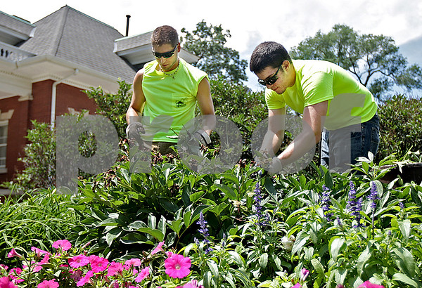 Monica Maschak - mmaschak@shawmedia.com<br /> Cory Lesniak (left) and Casey Smith, DeKalb Park District employees, prune and landscape the garden areas around the Ellwood House and Museum in DeKalb on Thursday, June 27, 2013. The property has recently undergone renovations to expand parking and make sidewalks more wheelchair accessible.