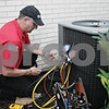 Rob Winner – rwinner@shawmedia.com<br /> <br /> Gregory Freeman owner of All-Star Heating and Air Conditioning performs a tune-up on a central air conditioning unit at a home in DeKalb on Tuesday, June 25, 2013.