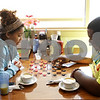 Rob Winner – rwinner@shawmedia.com<br /> <br /> Jonnetta Lyons (left) and Kawaune Williams, both of DeKalb, play a game of checkers while at Flippin Eggs located on South Fourth Street in DeKalb, Ill., Wednesday, June 19, 2013. The city of DeKalb is considering establishing a tax increment financing district along South Fourth Street to spur economic development in the area.