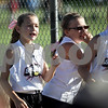 Monica Maschak - mmaschak@shawmedia.com<br /> Andrea Foulk (left), 9, cheers on her 10-and-under team from the dugout at the Storm Dayz softball tournament at Sycamore Community Park on Friday, June 28, 2013. Foulk and her sister, Abby, 18, play on the Kishwaukee Valley Storm softball league on age appropriate teams.