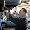 Rob Winner – rwinner@shawmedia.com<br /> <br /> Mike Ritz, owner of Ritz's Southtown Auto tests a solenoid on a vehicle in his shop on South Fourth Street in DeKalb, Ill., Wednesday, June 19, 2013. The city of DeKalb is considering establishing a tax increment financing district along South Fourth Street to spur economic development in the area. Ritz may seek TIF money to improve the cosmetics of his building and a new sign.