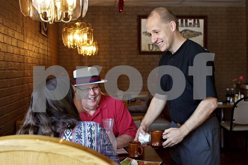 Rob Winner – rwinner@shawmedia.com<br /> <br /> (From left to right) Patty and Steve Tallitsch, both of DeKalb, are served by Flippin Eggs owner Scott Morrow at the restaurant located on South Fourth Street in DeKalb, Ill., Wednesday, June 19, 2013. The city of DeKalb is considering establishing a tax increment financing district along South Fourth Street to spur economic development in the area.