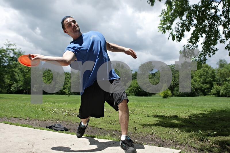 Rob Winner – rwinner@shawmedia.com<br /> <br /> DeKalb resident Luke LaMere makes his first throw on the ninth hole while playing disc golf at Prairie Park in DeKalb, Ill., Friday, June 28, 2013.