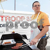 Erik Anderson - For the Daily Chronicle<br /> Nathan Overmann, 17, turns over polish hotdogs as Boy Scout Troop 33 held a fundraiser in DeKalb to raise money for a trip to Oklahoma on Sunday, June 23, 2013. The boy scouts will help the victims of the tornadoes that killed 40 people and damaged over 13,000 homes.