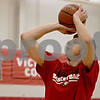 Monica Maschak - mmaschak@shawmedia.com<br /> Junior Jordan Threloff shoots a ball at a Northern Illinois University summer practice on Wednesday, June 19, 2013. Threloff is a DeKalb High School alumnus who spent his first two years of college at Illinois State University and will be transferring to NIU to play the center position on the basketball team.