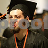 Monica Maschak - mmaschak@shawmedia.com<br /> Fred Imundo gets excited for the DeKalb High School commencement ceremony at the Northern Illinois University Convocation Center on Saturday, June 8, 2013. About 350 students graduated.