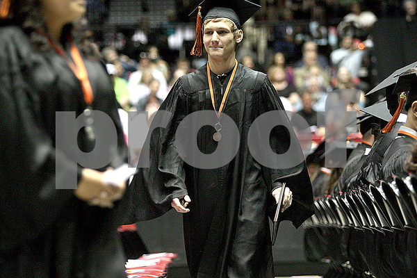 Monica Maschak - mmaschak@shawmedia.com<br /> Jonathon Boyd returns to his seat after getting his diploma during the DeKalb High School commencement ceremony at the Northern Illinois University Convocation Center on Saturday, June 8, 2013. About 350 students graduated.