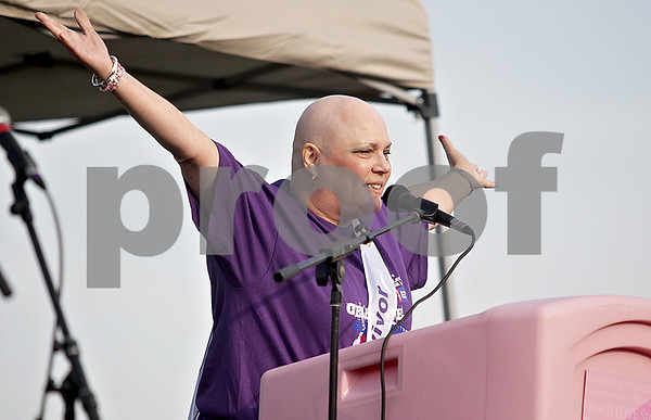 "Monica Maschak - mmaschak@shawmedia.com<br /> Mary Rehak, of DeKalb, speaks to the audience during the 17th annual Relay for Life of DeKalb County at Sycamore High School on Friday, June 14, 2013. ""I have been blessed to have cancer,"" Rehak said. Survivors, caregivers and supporters walked and raised money from 6 p.m. Friday until 6 a.m. Saturday."