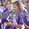 Monica Maschak - mmaschak@shawmedia.com<br /> Janae Heegaard, 9, of Sycamore, reads a message to her fellow survivors right before they walked their survivor lap during the 17th annual Relay for Life of DeKalb County at Sycamore High School on Friday, June 14, 2013. Heegaard beat Wilms' tumor, a kidney cancer found in children, 5 years ago. Survivors, caregivers and supporters walked and raised money from 6 p.m. Friday until 6 a.m. Saturday.