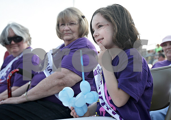 Monica Maschak - mmaschak@shawmedia.com<br /> Cancer survivor Raegan Mann, 6, of DeKalb, decides what candy she wants during the 17th annual Relay for Life of DeKalb County at Sycamore High School on Friday, June 14, 2013. Mann has been in remission from ganglioneuroblastoma for three years. Survivors, caregivers and supporters walked and raised money from 6 p.m. Friday until 6 a.m. Saturday.