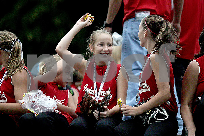 Monica Maschak - mmaschak@shawmedia.com<br /> Members of the Indian Creek Girls Softball team throw candy to spectators while riding along the parade route at the annual Shabbona Parade on Saturday, June 29, 2013.