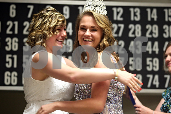 Monica Maschak - mmaschak@shawmedia.com<br /> Last year's Genoa Queen Taylor Almquist crowns Meredith Fitzsimmons as 2013's Genoa Queen at the 54 annual Genoa Days King and Queen Scholarship Contest on Wednesday, June 12, 2013. This year, sponsors were able to donate $1,000 scholarships to each the king and the queen.
