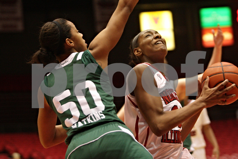 Rob Winner – rwinner@shawmedia.com<br /> <br /> Northern Illinois center Shaakira Haywood (right) is fouled by Eastern Michigan's Natachia Watkins in the first half at the Convocation Center in DeKalb, Ill., Thursday, Feb. 28, 2013.