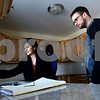 Kyle Bursaw – kbursaw@shawmedia.com<br /> <br /> Century 21 Elsner Realty Broker Maria Peña-Graham goes on a final walk-through of a Cortland home with buyers <br /> Ashley (back) and Tom Fawkes (right), checking to make sure the lights, dishwasher, water heater, stove and other pieces of the home are all functioning properly on Monday, Feb. 25, 2013.