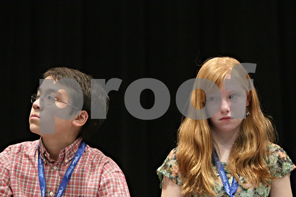 Rob Winner – rwinner@shawmedia.com<br /> <br /> The final two contestants, Matthew Rogers (left) and Cecilia Snider, listen to the rules for the final rounds of the DeKalb County Spelling Bee at Kishwaukee College in Malta, Ill., Saturday, Feb. 23, 2013.